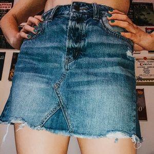 Mini distressed jean skirt
